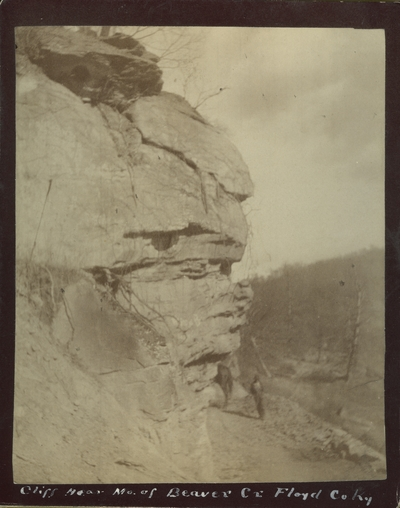 Unidentified man and horse beside a cliff near the mouth of Beaver Creek in Floyd County, Kentucky