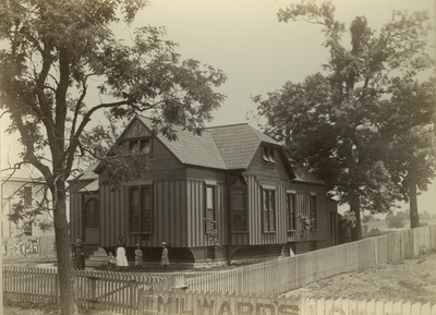 Unidentified women and children standing outside on the eastern side of the cottage of Albert R. Crandall (2)