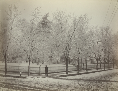 Snow scene with unidentified man taken at the corner of Broadway and High Streets in Lexington, Kentucky, March 29, 1883