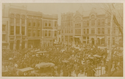View of Cheapside and Short, taken from courthouse; Hundreds of people gathered in street with horses and carriages