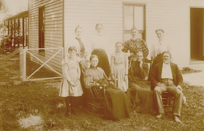Mrs. M.C. Lyle seated with family around her