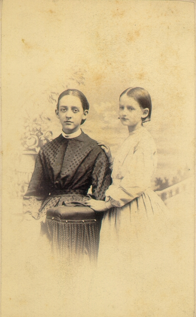 Lizzie and Helen Lyle standing by column