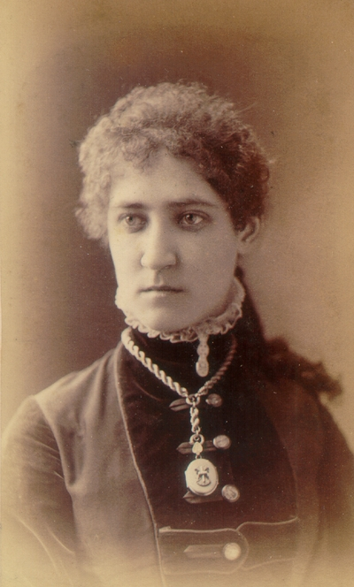Young woman wearing black dress and locket necklace; Western Female Seminary