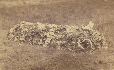 Burial site decorated with flowers; Similar to #331