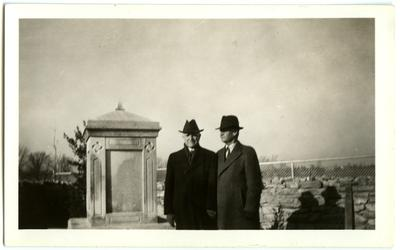Two men by Governor Isaac Shelby's grave at Traveler's Rest