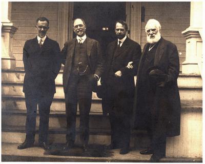 Charlton Hunt Morgan (1869-1934), C.S.A., Thomas Hunt Morgan (1866-1945), Alexander Graham Bell (1847 -1922), and Gilbert H. Grosvenor (1875-1966), standing outside of house