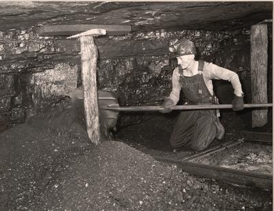 Harry Fain, coal loader, removes