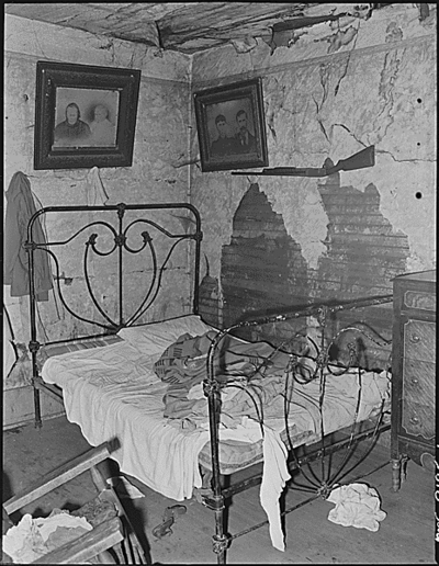 One of three rooms renting for $4 monthly in which eight people, four children and four adults, live.  This house is not owned by a coal mining company and is not rented through any company, but by an estate which rents this house to a miner.  Cary, Bell County, KY. 9/4/46