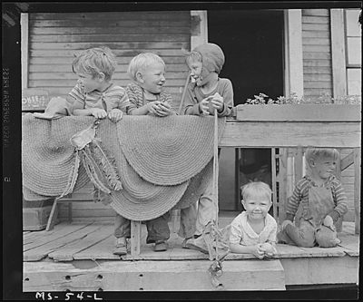 Children of miners on front porch of house in company project.  Osage, Monongalia County, W. Va. 6/14/46