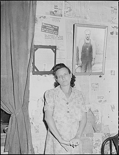 Mrs. Leanore Miller, widow of a miner, with a picture of her husband.  She said,