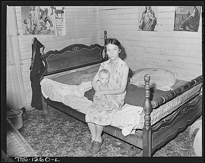 Mrs. Walter Rose, wife of miner, and her baby.  The baby probably has rickets and has never had any food other than powdered milk although he is ten months old.  The company doctor has not given her any instructions as to feeding and care of the child.  Welch, McDowell County, W. Va.8/10/46