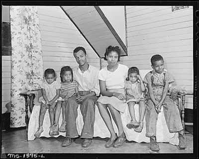 Mr. and Mrs. James Robert Howard and their four children.  They live in three rooms of a two-family house.  The rent is $7.90 monthly and charges for electricity run about $4 monthly.  Gilliam, McDowell County, W. Va.8/13/46