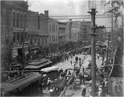 Shopping crowds on the west side of the 100 block of North Limestone;                          Labor Day 1902 handwritten on envelope