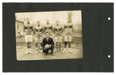 Group portrait: 1912 senior basketball players with coach