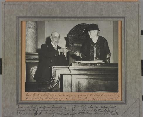 Governor Laffoon handing gavel to Laura Clay as Temporary Chairman of the Kentucky Convention to ratify the 21st Amendment to the Constitution. Miss Clay's acceptance address is written on the back of the photograph
