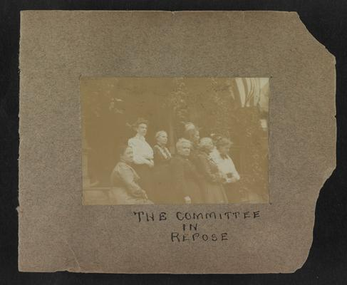 Handwritten title on album page: The Committee in Repose