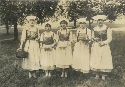 Five women in costumes