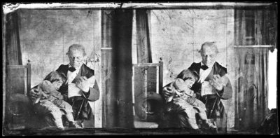 Glass negative of Dr. Peter holding A.M. Peter as a small child on his lap, 1860s