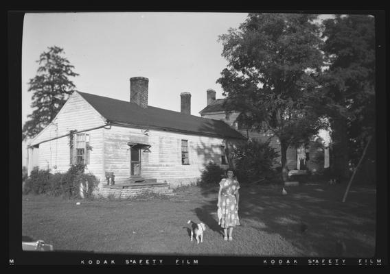 View of elle of a house on Redd Road, Fayette County, Kentucky. Iva Dagley pictured in photo