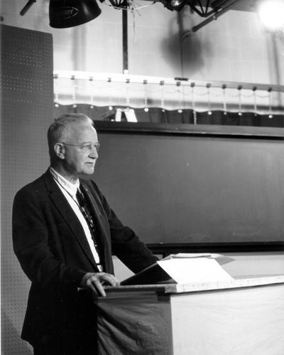 Man on studio set, facing cameras (George Brady)