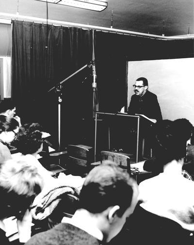 Folklore professor Dr. Bill Jansen, speaking to students in studio classroom;
