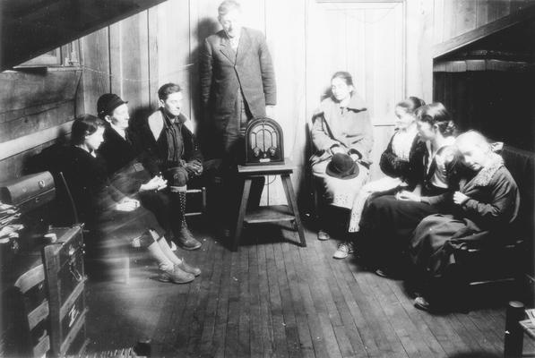 People gathered around radio at a Listening Center in Eastern Kentucky