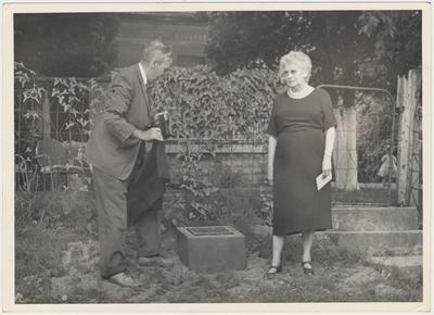 Man and woman unveiling the marker on the ground (August 13, 1961). The lady in the center is Mrs. Pearl Day Bach