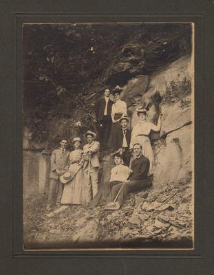 Five men and four women hiking, stop for a rest