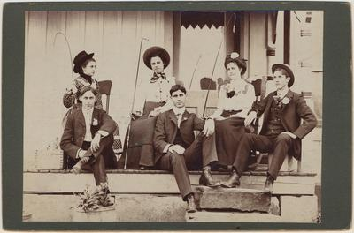 Group of three young men and three young women, sitting on a porch: Pearl Day, Mary Bereneman, Corda Benneman, George Ringe, Howard James and Ed D. Day