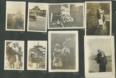 blurred photograph; building off in the distance with half of a car in front of it; a group photograph with men and women; a woman leaning against a building; a boy riding a horse; appears to be a picture of a ship; a woman and man standing together outside;