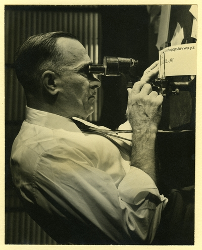 Chauncey Hawley Griffith looking through an eyepiece