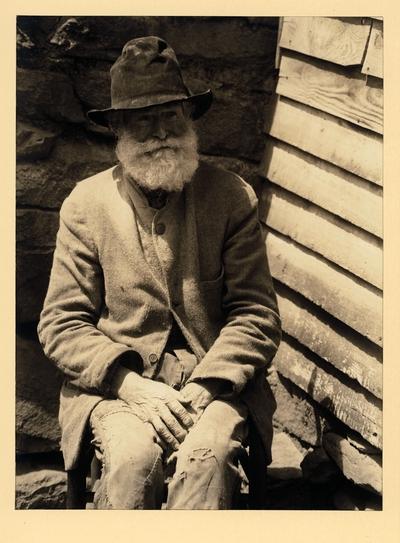 Old Man Miller; Wood Carver; Pine Log, North Carolina.  Elderly, bearded man in hat, coat, and ragged pants SAME AS 96PA100 #316
