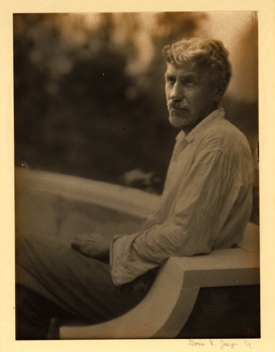 Charles R. Lamb;  Bearded man with mustache, in shirt and pants, seated on bench