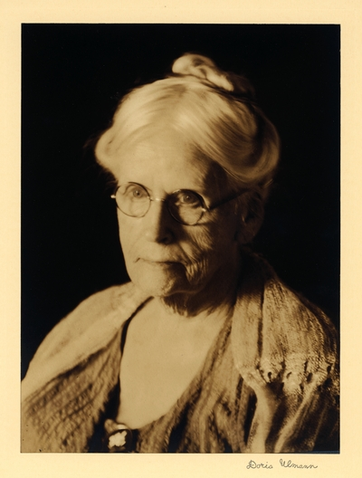 Mother of Sarah Blanding, of SC.  Head shot of elderly woman in glasses and shawl, with hair piled on top of her head