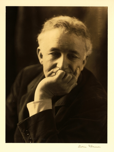 Allen Eaton; Head shot of man in coat with chin resting on hand