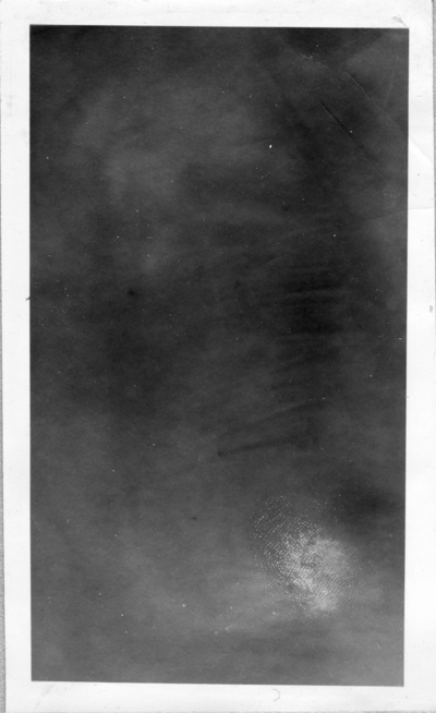 Black-and white photograph [mentioned in Item 3a]. Illegible                                 in normal light