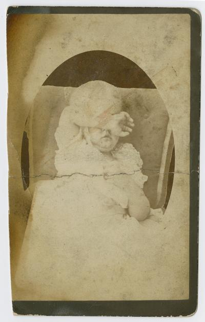 Linda Neville, aged about three years. She was at the photographer's and became non-cooperative