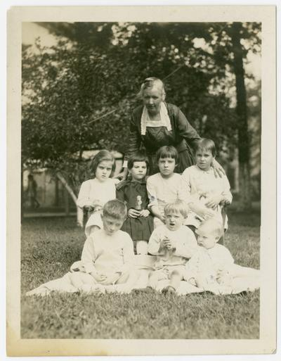 Linda Neville with seven young patients