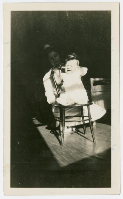 David Neville Devar in a high chair at the Arthur Sunshine Home