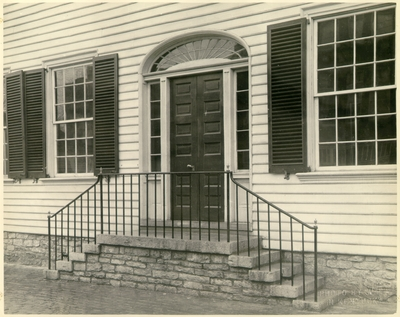 Exterior view of the door and plaque of the Ephraim McDowell House after renovation by the WPA.  Photos by the WPA with handwritten description on back of photo. 8x10