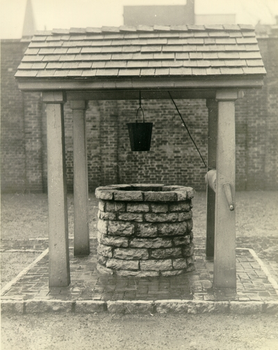 Exterior view of the well in backyard of the Ephraim McDowell House after renovation by the WPA.  Photos by the WPA with handwritten description on back of photo. 8x10