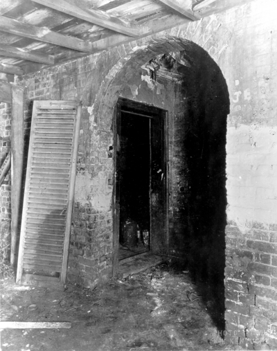 Interior view of the kitchen entrance fireplace of the Ephraim McDowell House prior to renovation by the WPA. Photos by the WPA with handwritten description on back of photo. 8x10