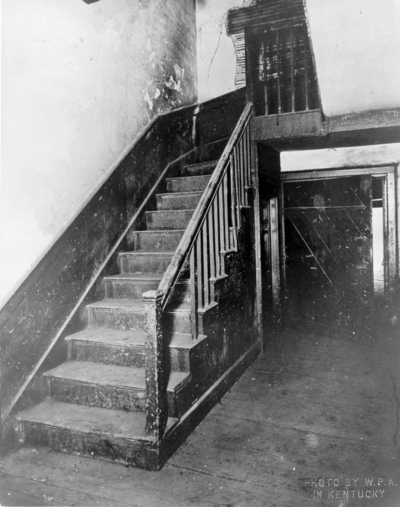 Interior view of the front stairs and doors to rear porch of  the Ephraim McDowell House prior to renovation by the WPA. Photos by the WPA with handwritten description on back of photo. 8x10
