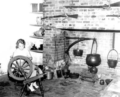 A variant print photograph by the Lexington Herald-Leader an interior view of the kitchen in the Ephraim McDowell House and an unidentified female. Reprints Sept 4  &  12 1952. 8x10 variant print