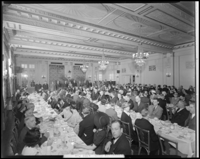 Bluegrass Automobile Club Banquet; Lafayette Hotel, interior;                             people sitting at banquet tables, group at the head table are                             standing