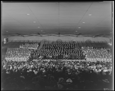 All State Chorus; Men's Gymnasium (Gym), University of                             Kentucky; interior, members sitting in bleachers, audience sitting in                             chairs on the court