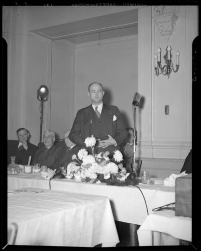 Kentucky Mining Institute; Lafayette Hotel, interior; Banquet;                             speaker standing in front of a microphone