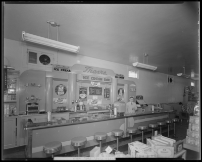 Travis Phar; Soda Fountain, 848 East High; interior view of ice                             cream bar, man standing behind the counter; photograph ordered by                             Sealtest Ice Cream Company