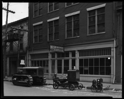 Wilson Machinery & Supply Company; 139-141 North Mill                             Street; exterior view of store front, machinery parked in front of                             building