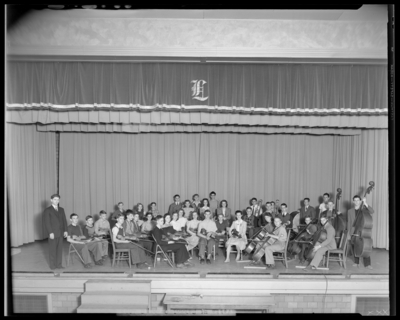 Orchestra, Lafayette High School; interior, orchestra members on                             stage; photographs requested by Dr. Crawford (Principal)
